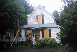 house with windows boarded up