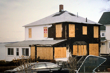 house boarded up after fire